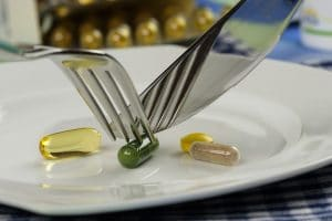 pills with fork and spoon