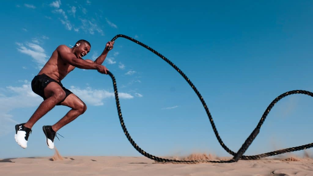 man exercising using ropes