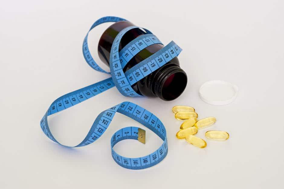 tape measure, pills, medicine-