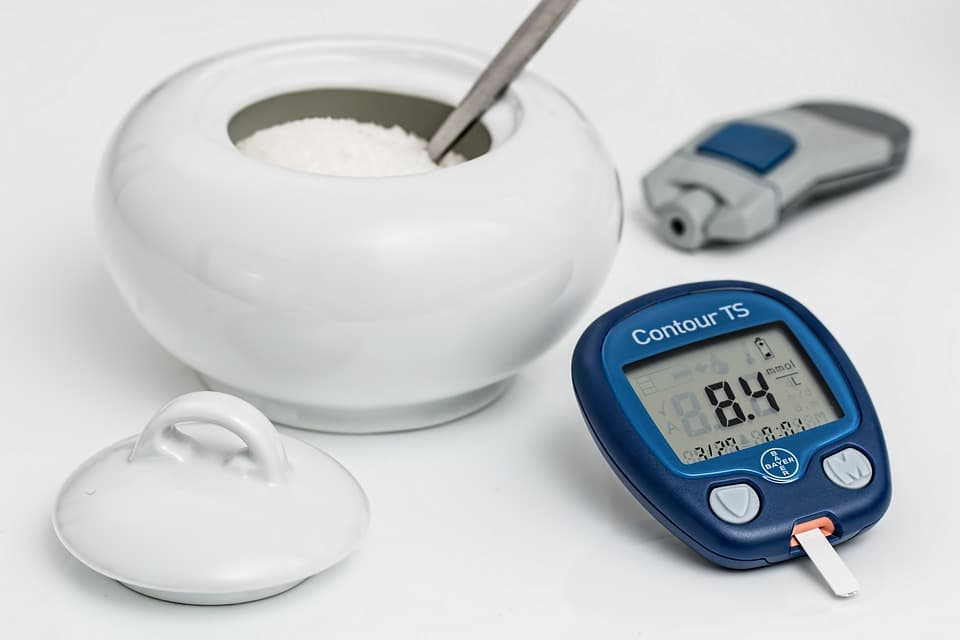 sugar in a container and an insulin reader at the side