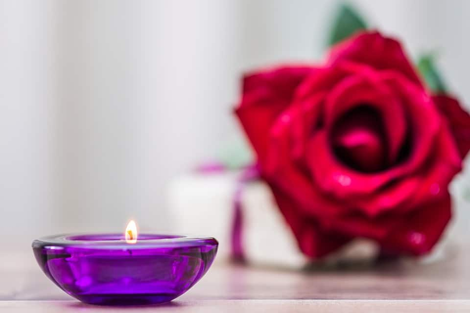 lighting candle and rose