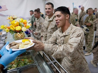 MILITARY men having their meals