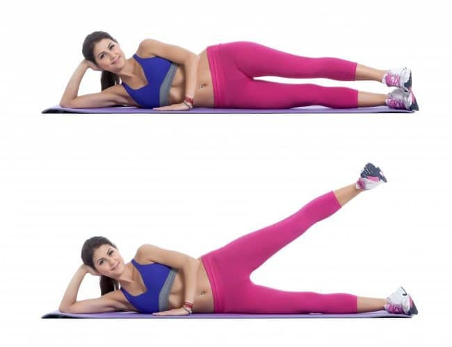 woman doing Lying Lateral Leg Raises