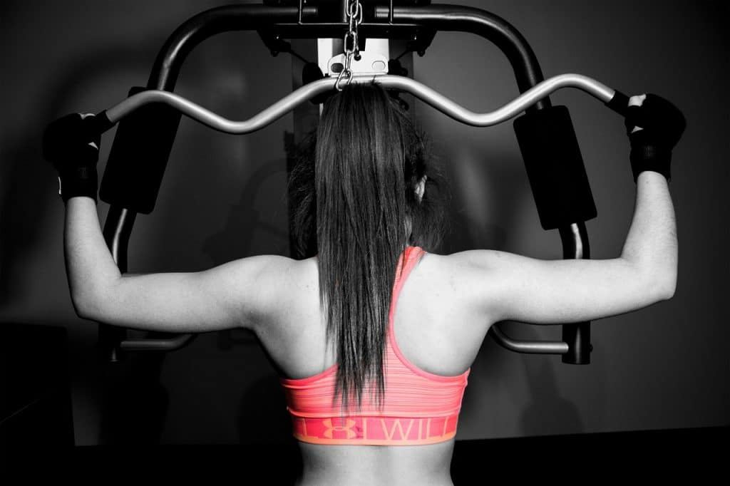 woman working out to show how to get rid of back fat