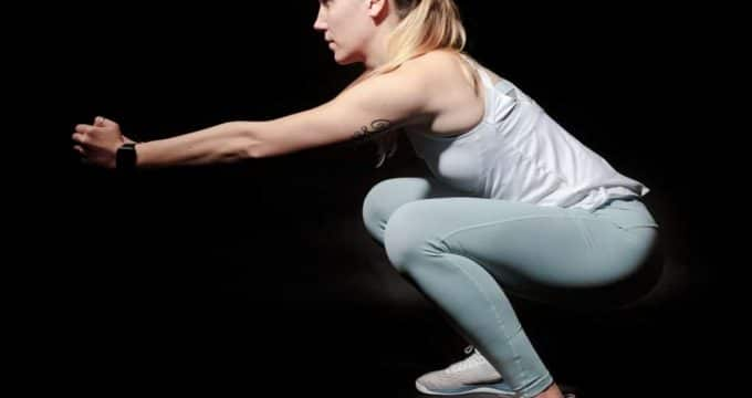 Woman wearing white shirt squatting