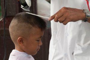 Boy getting his hair cut